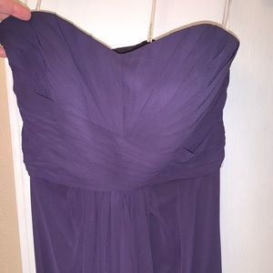 A long purple strapless gown.
